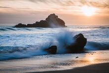 Wave Breaks Over Rock At Sunset, Pfeiffer Beach, Big Sur California