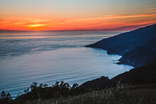 Sunset Over Pacific Ocean And Big Sur Coast From Mountain Peak.