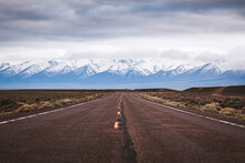 Empty Desolate Lonely Desert Road With Mountains In Distance, Nevada