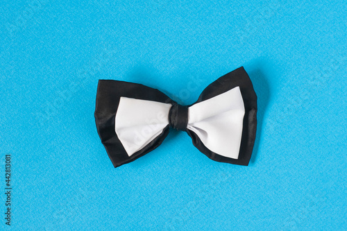 Canvas Black and white bow tie on a pastel blue Copy space background.
