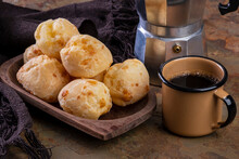 Table With Delicious Cheese Breads, A Coffee Mug And A Traditional Coffee Maker