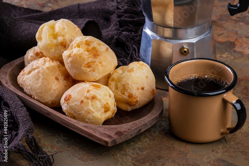 Canvas Print table with delicious cheese breads, a coffee mug and a traditional coffee maker