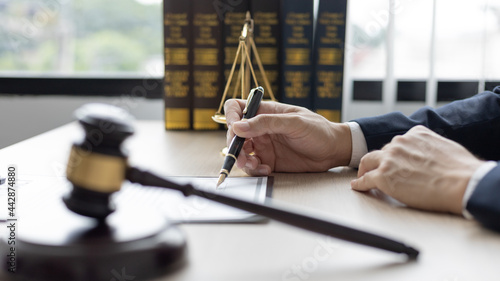 Canvas Print Lawyers or judges sign documents in accordance with legal and fair terms of agreement, Legal Ethics and Integrity, scales of justice, law hammer, Litigation and legal services