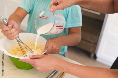Caucasian father and son baking together in kitchen