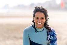 Smiling Ethnic Kitesurfer With Kiteboarding Equipment On Sea Shore