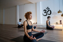 Peaceful Multiethnic People Meditating Together During Yoga Lesson
