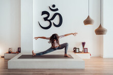 Graceful Woman Practicing Yoga In Side Lunge Pose