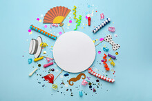 Flat Lay Composition With Carnival Items And Blank Card On Light Blue Background. Space For Text