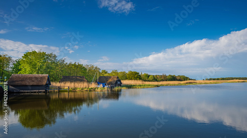 Foto Thatched boathouses in the port of the Baltic seaside resort Prerow, Mecklenburg