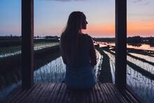 Blond Woman Sitting In A Rice Field In Kajsa