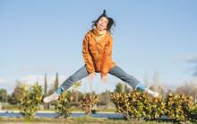 Carefree Woman Having Fun In Urban Park