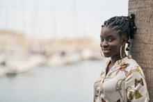 Happy Black Woman With Ethnic Braids And Earrings Looking At Camera