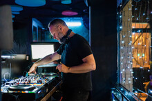 Inspired DJ Using Controller While Performing With Music Improvi