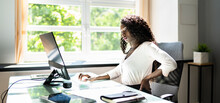 African Businesswoman Having Back Pain While Sitting