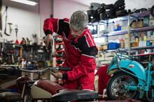 Professional Mechanic Fixing Handlebar Of Motorcycle