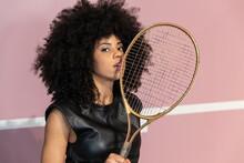 Black Woman With Tennis Racket In Studio