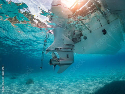 Fotografie, Obraz Underwater view of a outboard engine stern on a dinghy immersed in a turquoise sea