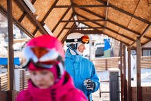 Happy Father In Helmet And Warm Activewear In Ski Resort