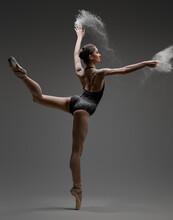 Artistic Ballerina Wearing Black Activewar And Dancing