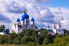 White Church Blue Domes At Summer Day