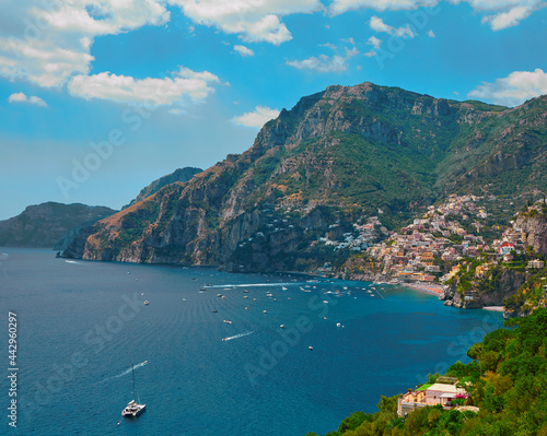 Carta da parati One of the best resorts of Italy with old colorful villas on the steep slope, nice beach, numerous yachts and boats in harbor and medieval towers along the coast, Positano