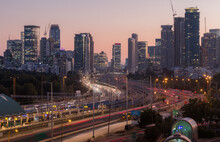 Tel Aviv, Israel - January 21, 2021: Tel Aviv And Ramat Gan Skyline Evening Panorama. Modern Skyscrapers And Ayalon Highway