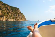 Woman Lounging On A Catamaran Sailboat