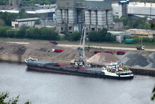 Barge On The River Unloading River Sand From A Barge Navigable River, River Port. High Quality Photo