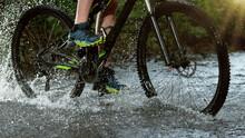 Close-up Of Mountain Rider Splashing Water In River