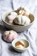Fresh Cloves Of Garlic And Garlic Bulbs On A Table