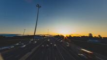 Long Exposure Shot Of Cars Commuting In The Morning On A Highway In Toronto, Canada.