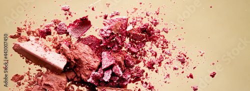 Fotografie, Tablou Crushed cosmetics, mineral organic eyeshadow, blush and cosmetic powder isolated on golden background, makeup and beauty banner, flatlay design