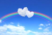 ハート型の雲と虹のかかった青空 2