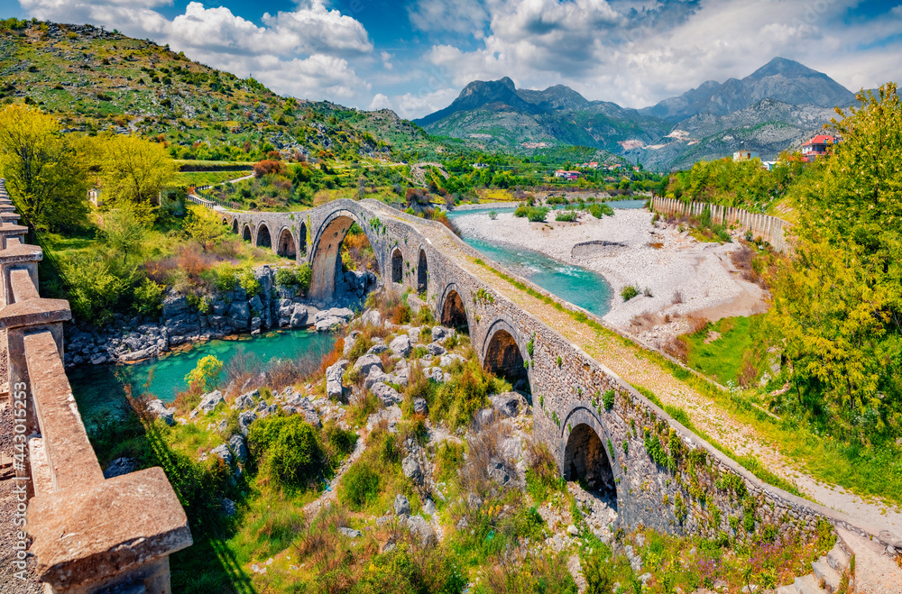Spectacular spring view of Old Mes Bridge. Wonderful morning landscape of Shkoder. Captivating outdoor scene of Albania, Europe. Traveling concept background.