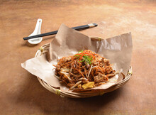 Traditional Stir Fried Bee Hoon Thin Noodle With Vegetables Dark Soy Sauce In Retro Basket On Wood Table Asian Halal Menu
