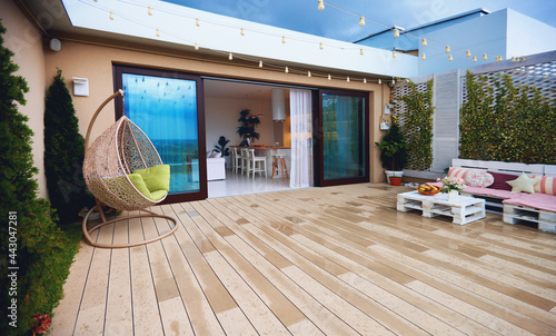 Canvas Print rooftop patio zone with sliding doors and open space kitchen at warm rainy day