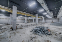 Construction Of Spacious Well-lit Underground Car Park With Parking Spaces. Empty Parking Garage Underground, Industrial Interior. Construction Works