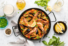 Seafood Paella Ready To Eat Served In A Paella Pan, Top-down View