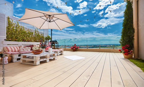 Canvas Print cozy rooftop patio with pallet furniture lounge zone and beautiful landscape vie