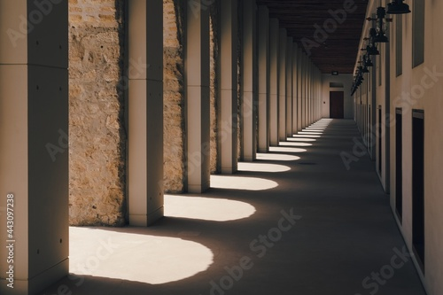 Billede på lærred Diminishing perspective view of fortress passageway with arches columns and row of antique lanterns on the wall