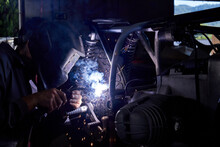 Anonymous Mechanic Welding Parts Of Motorcycle