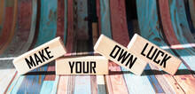 Make Your Own Happiness. Motivational Quote Written On Wooden Blocks And Stripe Background.