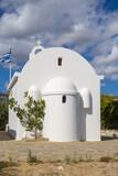 Fototapeta Kwiaty - Typical whitewashed Greek orthodox chapel in the Cycladic style on Paros island. Greece