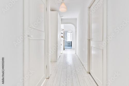 Fototapeta A long empty corridor designed in minimalistic style