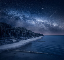 Milky Way Over Lighthouse By Baltic Sea. Beach With Stars