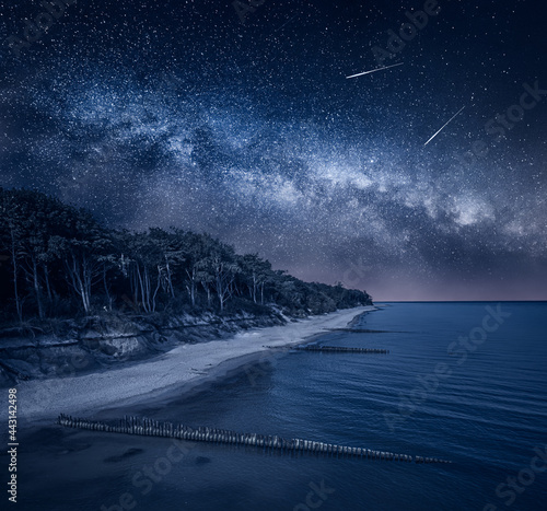 Fototapeta Milky way over Lighthouse by Baltic sea. Beach with stars