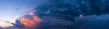 Dramatic Sunset Sky With Dark Stormy Clouds.
