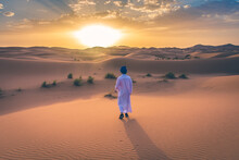 Berber Man Wearing Traditional Clothes In The Sahara Desert At Dawn, Morocco