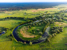 Aerial View Of Small Oxbow Lake With Trees