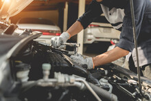 Automobile Mechanic Repairman Hands Repairing A Car Engine Automotive Workshop With A Wrench, Car Service And Maintenance,Repair Service.